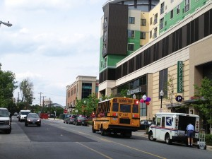 A school bus stops outside  the apartments at North Bethesda Market on Woodglen Drive.